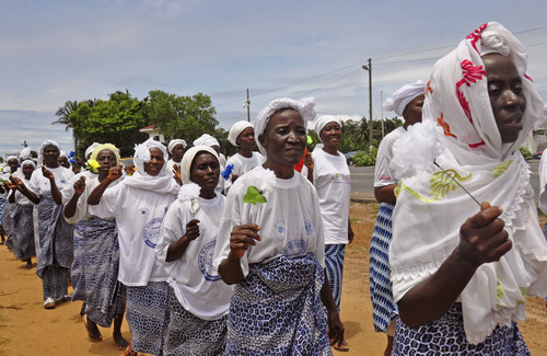 Liberia women sing after  praying for help with the Ebola virus, in the city of  Monrovia, Liberia.  Thursday, Aug. 14, 2014. Liberia faced an excruciating choice Thursday: deciding which handful of Ebola patients will receive an experimental drug that could prove either life-saving or life-threatening. ZMapp, the untested Ebola drug, arrived in the West African country late Wednesday. (AP Photo/Abbas Dulleh)