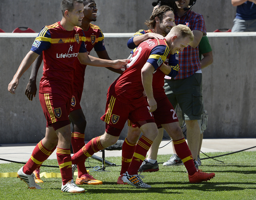 Scott Sommerdorf   |  The Salt Lake Tribune RSL midfielderLuke Mulholland, second from right, is mobbed by team mates after Mulholland's shot gave RSL a 2-0 lead early in the second half. RSL defeated the Seattle Sounders 2-1 at Rio Tinto Stadium, Saturday, August 15, 2014.