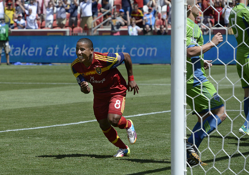 Scott Sommerdorf   |  The Salt Lake Tribune RSL forward Joao Plata rushes to congratulate Luke Mulholland after Mulholland's shot gave RSL a 2-0 lead early in the second half. RSL defeated the Seattle Sounders 2-1 at Rio Tinto Stadium, Saturday, August 15, 2014.