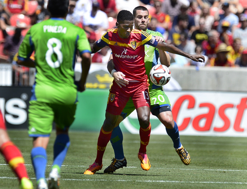 Scott Sommerdorf   |  The Salt Lake Tribune Seattle defenseman Zach Scott holds RSL forward Olmes Garcia during first half play. RSL defeated the Seattle Sounders 2-1 at Rio Tinto Stadium, Saturday, August 15, 2014.