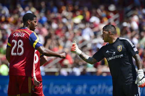 Scott Sommerdorf   |  The Salt Lake Tribune Defenseman Chris Schuler and GK Nick Rimando bump fists after a good defensive play during first half play. RSL defeated the Seattle Sounders 2-1 at Rio Tinto Stadium, Saturday, August 15, 2014.