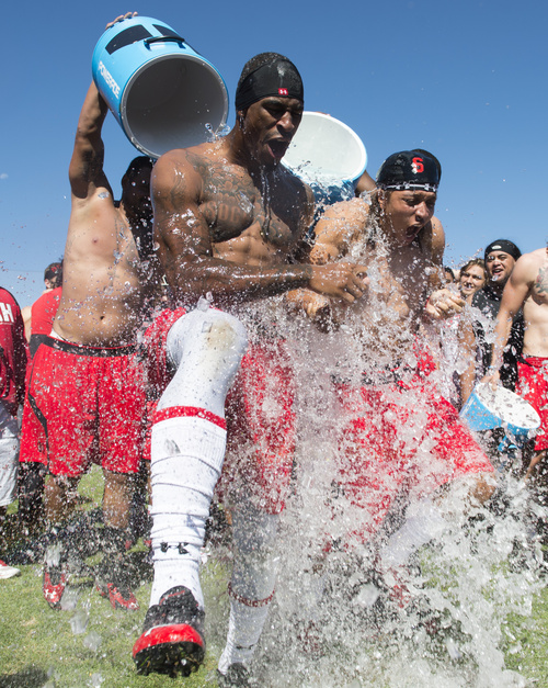 Rick Egan  |  The Salt Lake Tribune  Kenneth Scott and Dres Anderson react as ice water is poured on their heads as part of the Ice Bucket Challenge, to raise awareness for ALS, Friday, August 15, 2014