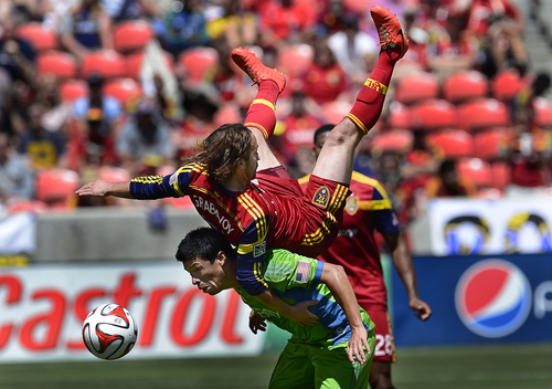 Scott Sommerdorf   |  The Salt Lake Tribune Ned Grabavoy takes a ride on the back of Seattle's Gonazlo Pineda after both men went up to attempt a header in the second half. RSL defeated the Seattle Sounders 2-1 at Rio Tinto Stadium, Saturday, August 15, 2014.