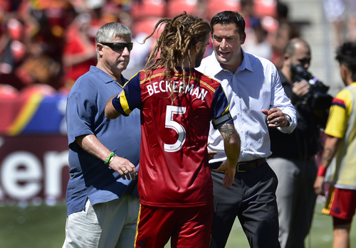 Scott Sommerdorf   |  The Salt Lake Tribune ESL coach Jeff Casar greets Kyle Beckerman after the final whistle on the field as Seattle coach Sigi Schmid walks by at left. RSL defeated the Seattle Sounders 2-1 at Rio Tinto Stadium, Saturday, August 15, 2014.