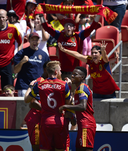 Scott Sommerdorf   |  The Salt Lake Tribune RSL fans join in as RSL players celebrate Joao Plata's goal that gave RSL a 1-0 lead early in the second half. RSL defeated the Seattle Sounders 2-1 at Rio Tinto Stadium, Saturday, August 15, 2014.