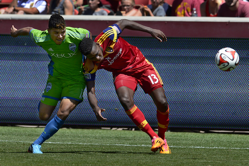 Scott Sommerdorf   |  The Salt Lake Tribune Seattle's DeAndre Yedlin pulls down RSL's Olmes Garcia earning him a yellow card and the ire of the RSL crowd who booed him every time he touched the ball in the second half. RSL defeated the Seattle Sounders 2-1 at Rio Tinto Stadium, Saturday, August 15, 2014.