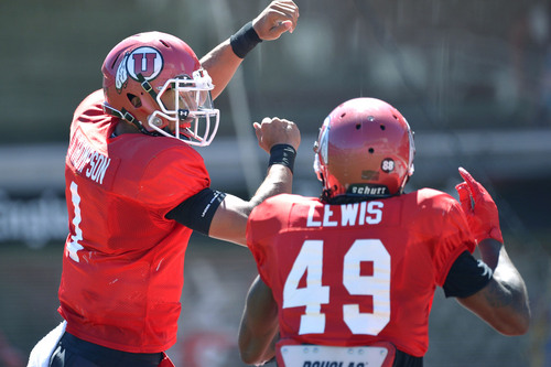 Chris Detrick  |  The Salt Lake Tribune Utah Utes Kendal Thompson celebrates his touchdown with Utah Utes wide receiver Andre Lewis (49) during a scrimmage at Rice-Eccles Stadium Saturday August 16, 2014.