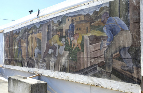 This Aug. 8, 2014 photo shows a large mural displayed at the Skagit County Fair in Mount Vernon, Wash. Its origin once a mystery, a Seattle art dealer confirmed on Friday, Aug. 15, 2014 that the canvas is an original 1941 painting by William Cumming. (AP Photo/The Skagit Valley Herald, Scott Terrell)
