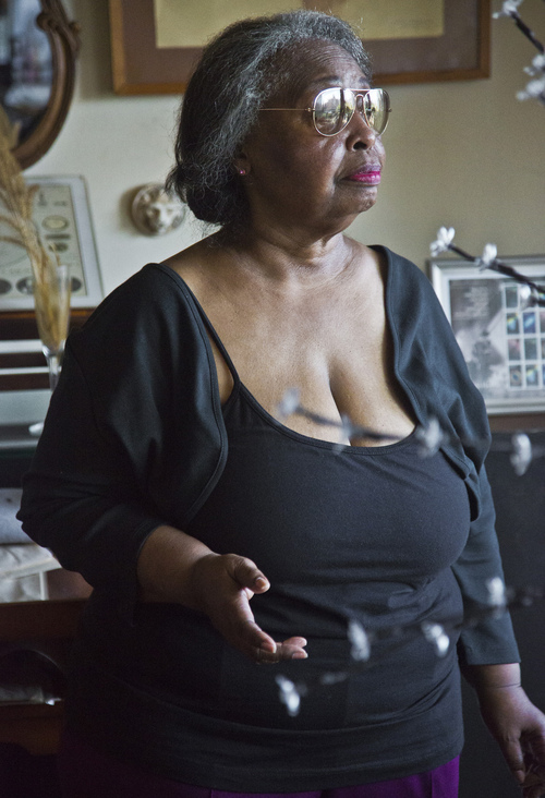In this Aug. 5, 2014 photo Jean Green Dorsey, stands in her rent-stabilized apartment on New York City's Upper West Side. Dorsey, who has lived in the apartment since 1972, is among a growing group of New Yorkers who reside in the same building with market rate residents who denied access to amenities available to market rate residents. (AP Photo/Bebeto Matthews)