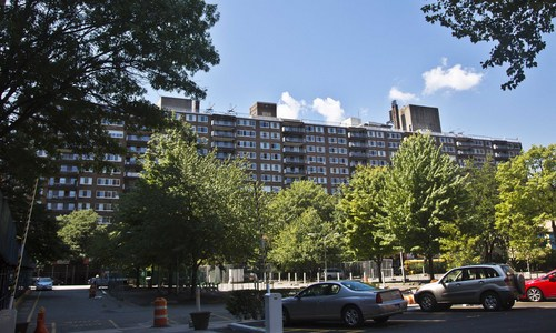 In this Aug. 5, 2014 photo, the front view of the Upper West Side, New York building where Jean Green Dorsey has lived over 40 years is shown.  With her status as a rent-stabilized tenant, Dorsey is prevented from using the gym which is designated for market-rate residents only.  A recent spate of buildings with separate amenities for the haves and have-nots is provoking an uncomfortable debate over equality, economics and the tightness of New York City's social fabric. (AP Photo/Bebeto Matthews)
