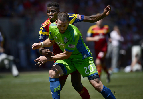 Scott Sommerdorf   |  The Salt Lake Tribune Olmes Garcia battles with Seattle's Zach Scott during second half play. RSL defeated the Seattle Sounders 2-1 at Rio Tinto Stadium, Saturday, August 15, 2014.