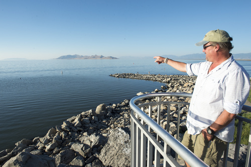 Rick Egan  |  The Salt Lake Tribune  Great Salt Lake State Marina harbormaster Dave Shearer points to the buoy that marks the spot of a boat that sunk nearly 70 years ago, that has been recently discovered near the marina, Saturday, August 16, 2014