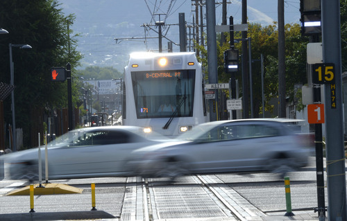 Al Hartmann  |  The Salt Lake Tribune  The Sugar House streetcar stops for a car steaking by on 700 East Wednesday August 13, 2014.  It is only slightly faster than the nearby parallel bus, and pedestrians sometimes can outrace it. Far fewer people than projected are riding it. And it was expensive, $37 million. But officials still see it as a success and worth the price because of the economic development it has attracted.