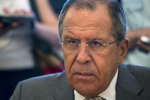 Russian Foreign Minister Sergey Lavrov listens to Palestinian negotiator Saeb Erekat during their meeting in Moscow, Russia, Tuesday, Aug. 19, 2014. Erekat's visit to Moscow is part of an effort to gain international support as Palestinian negotiators in Cairo try to hammer out a deal with Israel on the future of the war-torn Gaza Strip. (AP Photo/Alexander Zemlianichenko)