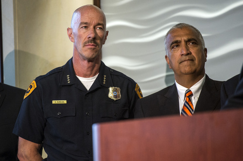 Chris Detrick  |  The Salt Lake Tribune Salt Lake Police Chief Chris Burbank and Salt Lake County District Attorney Sim Gill listen as FBI Director James Comey speaks during a press conference at the FBI Field Office in Salt Lake City Tuesday August 19, 2014.