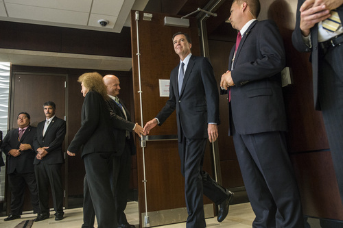 Chris Detrick  |  The Salt Lake Tribune FBI Director James Comey arrives to a press conference at the FBI Field Office in Salt Lake City Tuesday August 19, 2014.