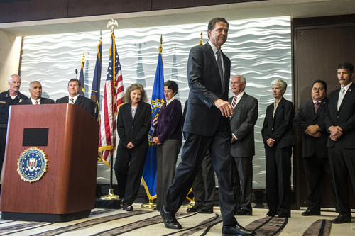 Chris Detrick  |  The Salt Lake Tribune FBI Director James Comey leaves after a press conference at the FBI Field Office in Salt Lake City Tuesday August 19, 2014.