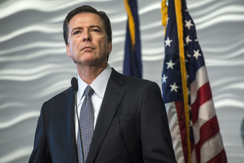 Chris Detrick  |  The Salt Lake Tribune FBI Director James Comey speaks during a press conference at the FBI Field Office in Salt Lake City Tuesday August 19, 2014.