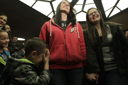 Leah Hogsten  |  Tribune file photo  Chantel Buhler, left, and spouse Laura Fernandez  giggle at their son Kayson, 4, after the two were officially married by the Rev. Curtis L. Price in the lobby of the Salt Lake County offices last December. Several hundred people descended on the Salt Lake County Clerk's Office to get licenses.