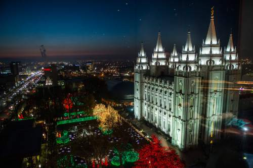 Chris Detrick  |  Tribune file photo Visitors look at the Christmas lights on Temple Square Friday November 29, 2013.