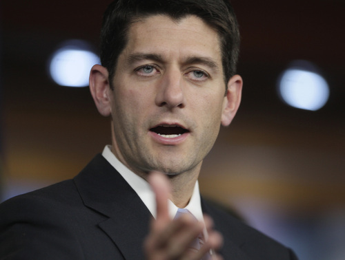 FILE - In this April 13, 2011 file photo, House Budget Committee Chairman, Rep. Paul Ryan, R-Wis., gestures during a news conference on Capitol Hill in Washington. In his new book, Ryan said he feared the GOP attitude heading into the government shutdown. (AP Photo/Carolyn Kaster, File)