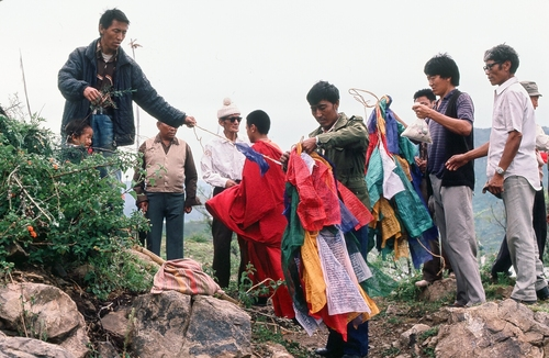 (Courtesy  |  Researchers, University of Utah) Tibetans living in India prepare a prayer flag during a festival. Researchers from the University of Utah have found a gene mutation is responsible for Tibetans' ability to thrive at high altitutdes. The research team visited the Tibetan Plateau in China as well as Tibetan communities in India several times.