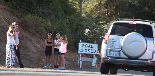 Residents wait at the road closed sign on Bristlecone in Wofford Heights, Calif, Monday, Aug. 18, 2014. The fire in Wofford Heights near Lake Isabella has grown to about slightly more than 1 square mile, or 800 acres, the U.S. Forest Service said.  (AP Photo/The Bakersfield Californian, Casey Christie)  MANDATORY CREDIT; MAGS OUT; NO SALES; ONLINE OUT; TV OUT