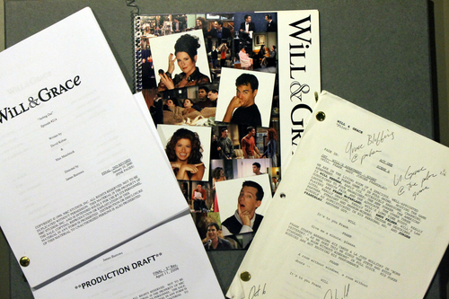 """This handout photo provided by the Smithsonian National Museum of American History shows production scripts and press materials from NBC's Will & Grace program, 2000-2006. Max Mutchnick and David Kohan, the creative power behind the hit situation comedy, intentionally presented LGBT characters who were not stereotyped, caricatured, or demeaned. The success of Will & Grace marked a turning point in media portrayals. The museum is acquiring several pieces of history from the gay, lesbian, bisexual and transgender community, including items from the TV show """"Will and Grace."""" (AP Photo/Smithsonian National Museum of American History)"""
