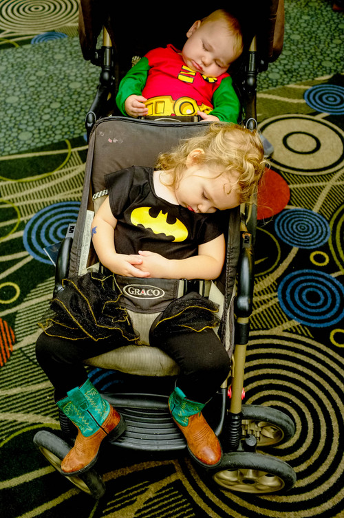 Trent Nelson  |  The Salt Lake Tribune Lanaya and Liam Parson, Batman and Robin, crashed out in their stroller after a day at Salt Lake Comic Con in Salt Lake City Saturday, September 7, 2013.