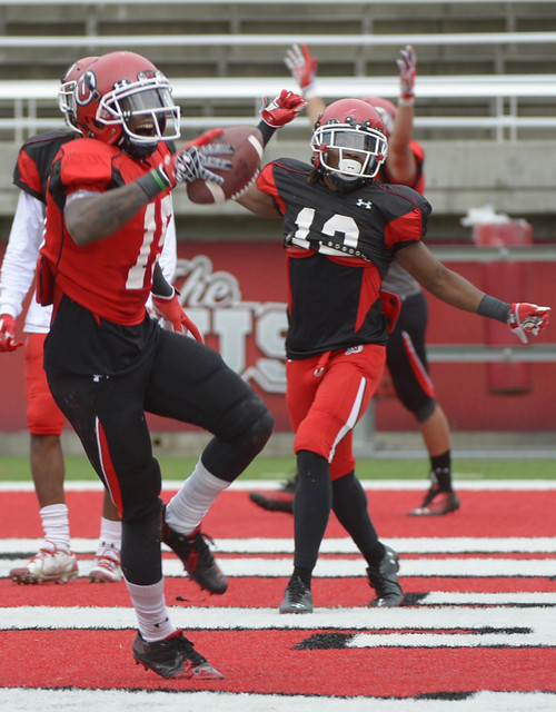 Leah Hogsten  |  The Salt Lake Tribune Wide receiver Dominique Hatfield celebrates his touchdown run with teammates. The University of Utah football team practices Tuesday, April 15, 2014, at Rice-Eccles Stadium.