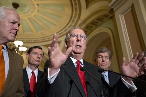 (AP Photo/J. Scott Applewhite, File) In this Feb. 26, 2013, file photo Senate Minority Leader, Republican Mitch McConnell, R-Ky., and Senate GOP leadership answer questions about the looming automatic spending cuts after a Republican strategy session on Capitol Hill in Washington. McConnell says another a government shut down is possible.