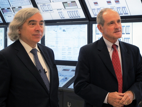 U.S. Energy Secretary Ernest Moniz, left, and U.S. Sen. Jim Risch, R-Idaho, talk about Idaho's nuclear research efforts at the Idaho National Laboratory in Idaho Falls on Wednesday, August 20, 2014. Moniz spoke at the inaugural Intermountain Energy Summit. Moniz says the United States isn't shunning coal or oil energy sources, but instead, officials are finding ways to reduce their carbon emissions. (AP Photo/Kimberlee Kruesi)