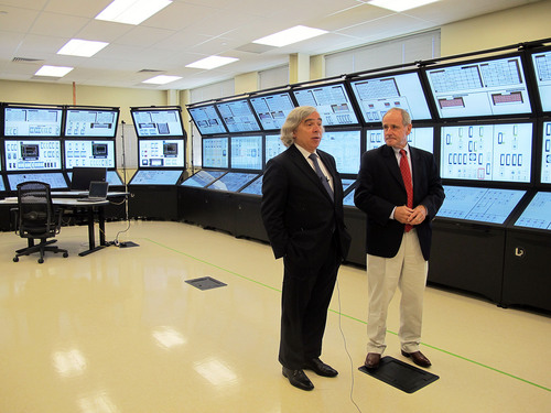 U.S. Energy Secretary Ernest Moniz, left, and U.S. Sen. Jim Risch, R-Idaho, talk about Idaho's nuclear research efforts at the Idaho National Laboratory in Idaho Falls on Wednesday, Aug. 20, 2014. Moniz spoke at the inaugural Intermountain Energy Summit. Moniz says the United States isn't shunning coal or oil energy sources, but instead, officials are finding ways to reduce their carbon emissions. (AP Photo/Kimberlee Kruesi)