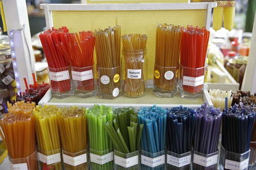 In this Tuesday, July 22, 2014 photo, an assortment of flavored honey straws are shown on display at the Marshall's Farm Honey stand at the Oxbow Public Market in Napa, Calif. California's record three-year drought has left hillsides barren and forced farmers to tear out orchards and leave fields fallow. Beekeepers are scrambling to find new flowers for their hives, feeding them artificial nectar or sending them out of state. (AP Photo/Eric Risberg)