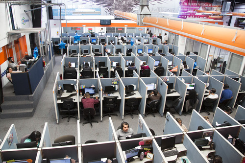 In this Aug. 13, 2014 photo, an overall view of the Firstkontact Center, a call center in the northern border city of Tijuana, Mexico. Many Mexicans deported under U.S. President Barack Obama are finding employment in call centers in Tijuana and other border cities. In perfect English, some don't even speak Spanish, they talk to American consumers who buy gadgets and gizmos, have questions about warrantees and complain about overdue deliveries. A large number of workers spent nearly all their lives in the U.S. and still have family there, a major selling point for Mexico over English-language industry leaders like India and the Philippines. (AP Photo/Alex Cossio)