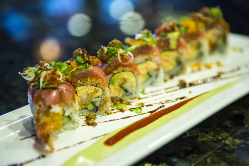 Chris Detrick  |  The Salt Lake Tribune The Low Rider roll with spicy crap, tempura shrimp, avocado, cucumber, spicy tuna, yellowtail, dried shallots, jalapeño, lime, wasab and green onions ($12) made by Mai Nguyen at Sapa Sushi Bar & Grill in Salt Lake City.