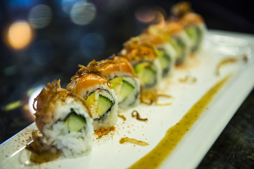 Chris Detrick  |  The Salt Lake Tribune The Samurai roll with crab, avocado, cucumber, seared salmon, chili flakes, sesame dressing and fried onions made by Mai Nguyen at Sapa Sushi Bar & Grill in Salt Lake City. Nguyen was recently named Woman Business Owner of the Year by the Salt Lake chapter of the National Association of Women Business Owners. Nguyen and her family own four Salt Lake County restaurants: Sapa Sushi Bar, Bucket O'Crawfish, Fat Fish and Noodle and Chop Stick.