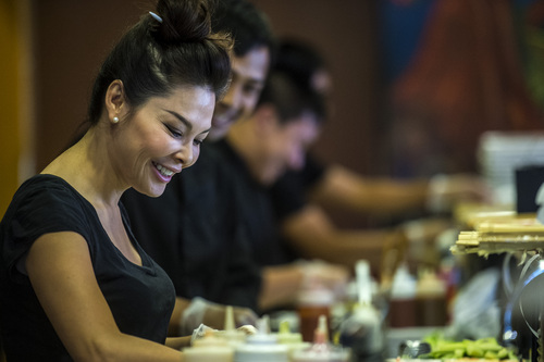 Chris Detrick  |  The Salt Lake Tribune Mai Nguyen makes sushi at Sapa Sushi Bar & Grill in Salt Lake City Wednesday August 13, 2014.  Nguyen was named Woman Business Owner of the Year by the National Association of Women Business Owners.  Nguyen and her family own four  Salt Lake County restaurants: Sapa Sushi Bar, Bucket O'Crawfish, Fat Fish and Noodle and Chop Stick. Mai is a American success story, having immigrated from Vietnam when she was 9, along with her parents and 6 younger siblings.