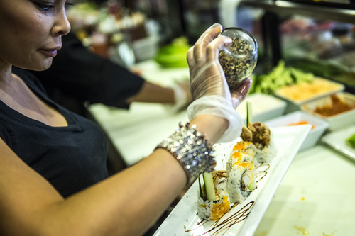 Chris Detrick     The Salt Lake Tribune Mai Nguyen makes sushi at Sapa Sushi Bar & Grill in Salt Lake City Wednesday August 13, 2014.  Nguyen was named Woman Business Owner of the Year by the National Association of Women Business Owners.  Nguyen and her family own four  Salt Lake County restaurants: Sapa Sushi Bar, Bucket O'Crawfish, Fat Fish and Noodle and Chop Stick. Mai is a American success story, having immigrated from Vietnam when she was 9, along with her parents and 6 younger siblings.