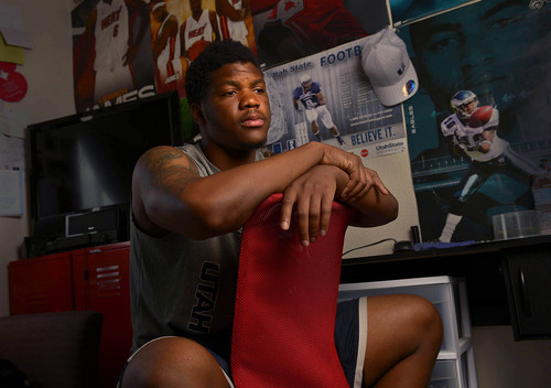 Leah Hogsten  |  The Salt Lake Tribune Although college football is growing as an industry, the players who win the games aren't seeing much of the spoils. Former Utah State University  linebacker Tavaris McMillian sends money to his family every month and scrapes by on his scholarship stipend. McMillian, shown in his apartment room Wednesday, August 13, 2014 in Logan, is beginning to worry about his finances in the coming months when his scholarship dries up.  While athletes do get some perks, many struggle when it comes to paying bills and feeding themselves on their scholarship checks.