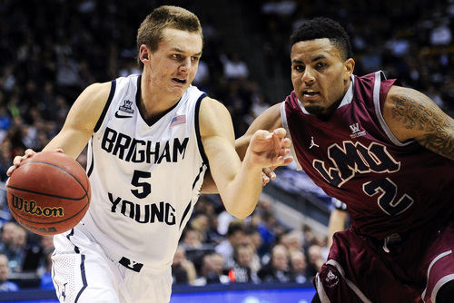 BYU guard Kyle Collinsworth, left, attempts to drive past Loyola Marymount's C.J. Blackwell during an NCAA college basketball game on Saturday, Jan. 11, 2014, in Provo, Utah. (AP Photo/Daily Herald, Alex Goodlett)