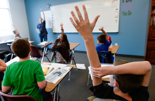 Francisco Kjolseth  |  The Salt Lake Tribune Fifth-grade students at Spectrum Academy's second campus participate in class in Pleasant Grove during the first day of classes on Tuesday, Aug. 19, 2014.