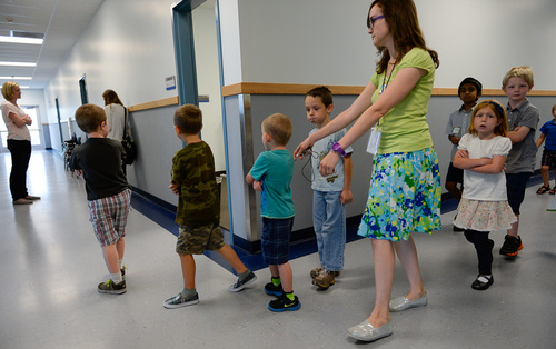Francisco Kjolseth  |  The Salt Lake Tribune Spectrum Academy first-graders file down the hall during the first day of school at Spectrum Academy in Pleasant Grove. The charter school primarily caters to kids with autism and has a long waiting list despite just opening their second campus.