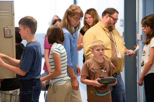 Francisco Kjolseth  |  The Salt Lake Tribune Spectrum Academy's second campus began their first day of classes on Tuesday, Aug. 19, 2014 in Pleasant Grove, as busy hallways were filled with students trying to figure out their classroom assignments. The charter school primarily caters to students with autism, and has a long waiting list to get in.