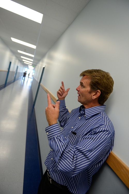 Francisco Kjolseth  |  The Salt Lake Tribune Brad Nelson, director of development and finance for Spectrum Academy talks about the non-flickering fluorescent lighting that was installed in the public charter school to aid students with autism. The second campus just built in Pleasant Grove, primarily caters to kids with autism and has a long waiting list to get in.