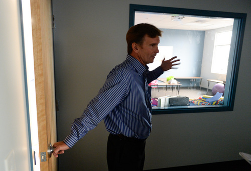 Francisco Kjolseth  |  The Salt Lake Tribune Brad Nelson, director of development and finance for Spectrum Academy, talks about an observation room built between two classrooms with one-way glass that aids in keeping track of students progress. The second campus just built in Pleasant Grove, primarily caters to kids with autism and has a long waiting list to get in.