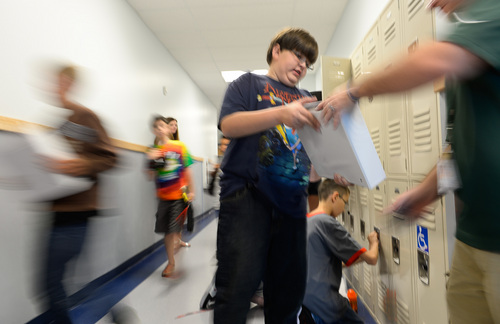 Francisco Kjolseth  |  The Salt Lake Tribune Spectrum Academy's second campus began their first day of school on Tuesday, Aug. 19, 2014 in Pleasant Grove, as busy hallways were filled with students trying to figure out their classrooms. The charter school primarily caters to students with autism, and has a long waiting list to get in.