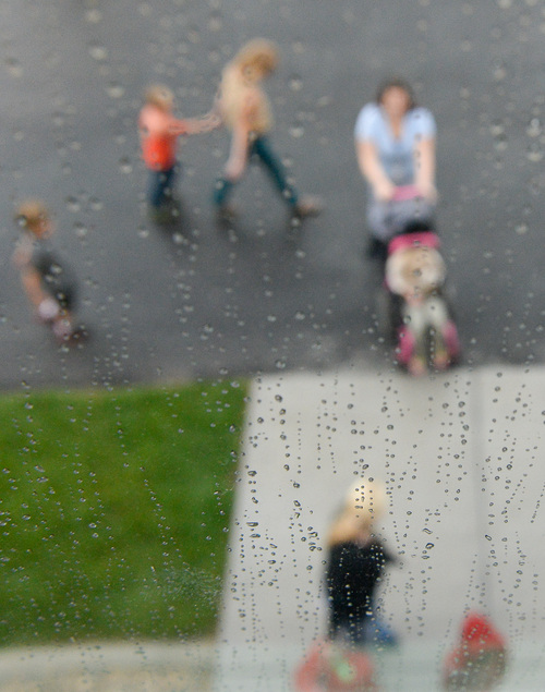 Francisco Kjolseth  |  The Salt Lake Tribune Kids return to class after playing in the rain at Spectrum Academy in Pleasant Grove. The public charter school, which primarily serves students with autism, has a long waiting list and currently has 430 students.