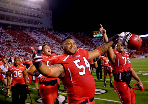 Trent Nelson  |  The Salt Lake Tribune Utah Utes offensive linesman Isaac Asiata (54) joins his teammates singing Utah Man after the win as the University of Utah hosts Utah State, college football Thursday, August 29, 2013 at Rice-Eccles Stadium in Salt Lake City.