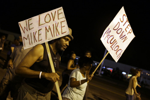 Jeff Roberson  |  The Associated Press Protesters again gathered Thursday evening in Ferguson, Mo., walking in laps near the spot where Michael Brown was shot. Some were in organized groups, such as clergy members. More signs reflected calls by protesters to remove the prosecutor, Robert McCulloch, from the case.